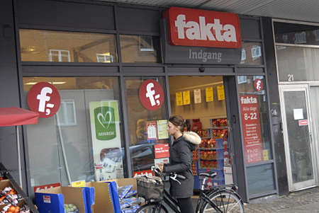 opening hours: Copenhagen Denmark- 04  December   2013  _   Big discount market undermind small food market and shops due to long opening hours and selling cheaps then small shops and stores