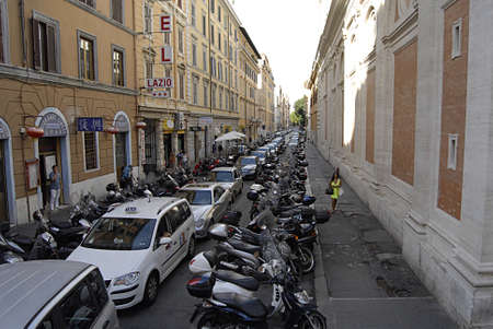 trafic: ROMEITALY_transport parking motor bgikes and auto park in street  daily trafic life in Rome 31 August 2013        Editorial