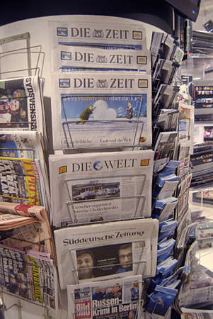 eldlery: Copenhagen Denmark-  21  December  2013 _Senior male studing news at news stand