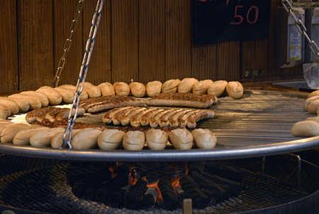 kastrup: Kastrup Denmark-  24 December  2013 _german Sausages and bread on sale at christmas market