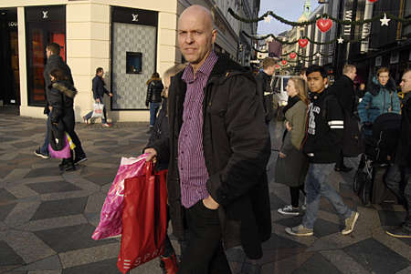 e 27: Kastrup Denmark-  27 December  2013  _Today in Denmark call exchange return christmas presents and sale day after christmas celebration consumer with shopping bags some to buy new some to buy on sale and some e hange all present those do not fit or in ta Editorial