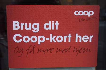 fakta: KASTRUPCOPENHAGEN Denmark-   3 January 2014_Female consumeer shoping at coop own fakta food chain and  message for consumer is use your Copp card here