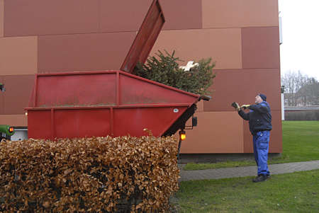 deere: KASTRUPCOPENHAGEN Denmark-   6 January 2014   _Tow danish landscapers collecting waste christmas trees and transporting with  United States made John Deere tractor          Editorial