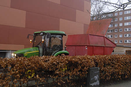 KASTRUPCOPENHAGEN Denmark-   6 January 2014   _Tow danish landscapers collecting waste christmas trees and transporting with  United States made John Deere tractor