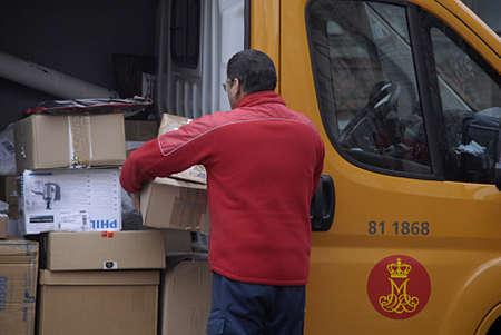mailmen: COPENHAGEN Denmark-   14 anuary 2014    _Male works with Post Denmark postal parcel service