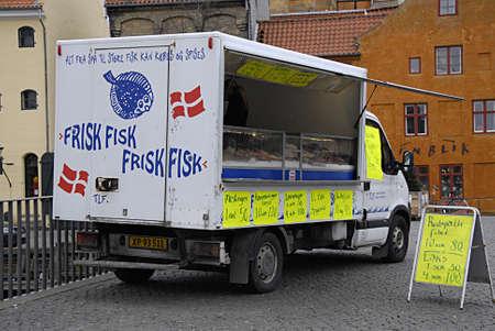 fish selling: COPENHAGEN Denmark-   23 anuary  2014    _Danish mobil fish selling truck moves varioius place in nation