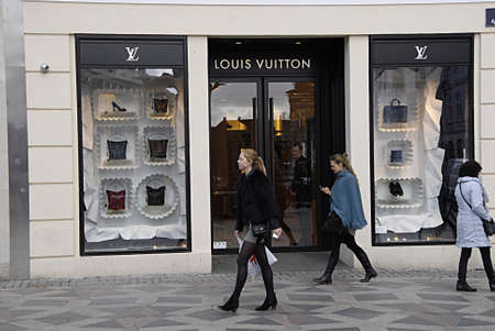 mondays: COPENHAGEN DENMARK-  Mondays shoppers on stroeget pass by Louis Vuitton store       24 Marchi 2014