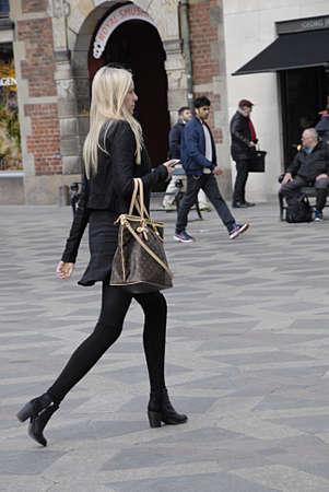 louis vuitton: COPENHAGEN DENMARK-  Mondays shoppers on stroeget pass by Louis Vuitton store       24 Marchi 2014