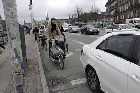 trafic: COPENHAGEN DENMARK-Danish trafic minister wants Bikebox for bycyclest to ride bike safe and sound through city idea came from Netherlands land of bikes riders         25 Marchi 2014