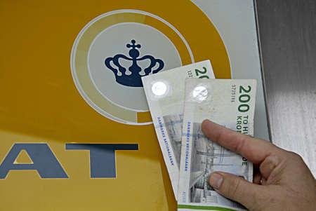 skat: KASTRUP COPENHAGEN DENMARK-  Danish ministry for TAX and revune (skat) will return some skat and tax money back to nation due to report in media       04 April 2014  Editorial