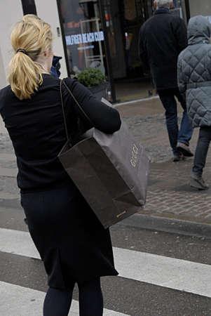 gucci: COPENHAGEN DENMARK-  Gucci shopper with shopping bag on stroeget        09 April 2014   Editorial