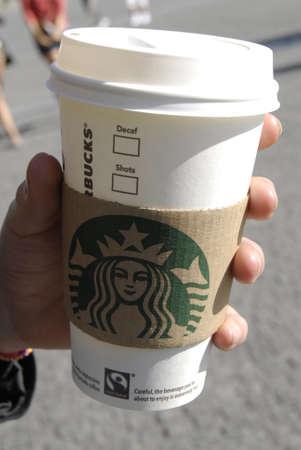 starbucks: LONDON ENGLAND UK _Starbucks cup coffee 9 Sept. 2012           Editorial