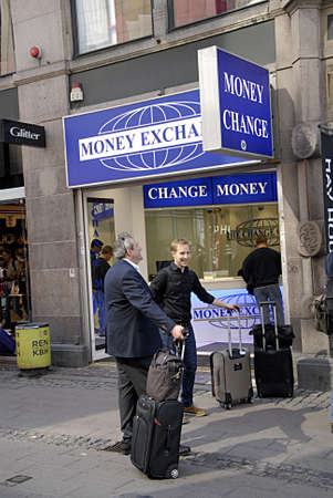 money exchange: COPENHAGEN DENMARK-  Travelers at money exchange on stroeget        30 April 2014