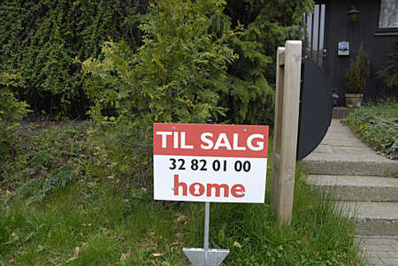 kastrup: KASTRUP COPENHAGEN DENMARK-  Home sale sign  ( til salg ) at street alleen in kastrup       06 May 2014   Editorial