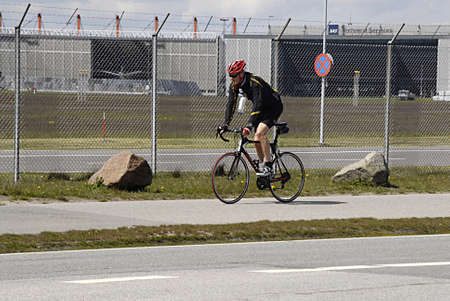 kastrup: KASTRUP COPENHAGEN DENMARK- Male bicycle rider  practice bicycle in kastrup          03 May 2014   Editorial