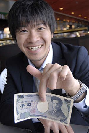 business traveler: KASTRUP COPENHAGEN DENMARK- Japanese business traveler with his yens 16 May 2014
