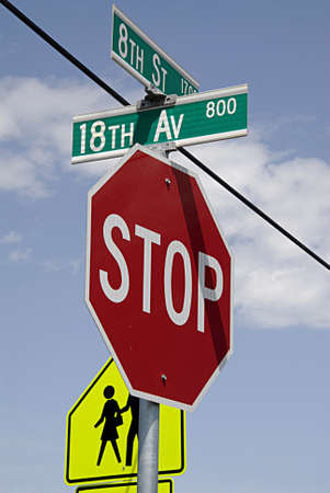trafic: LEWISTONIDAHO USA-  Trafic signs for motorest Stop and pedestrain at 8th street  and 18th avenue         27 May 2014   Editorial