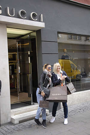 gucci: COPENHAGEN DENMARK-   Gucci shoppers with gucci shopping bags on stroget        26 JUNE 2014