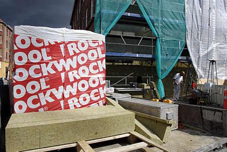 rockwool: KASTRUP COPENHAGEN DENMARK- Male worker using rockwool isolation to protact condo from cold weather        02 July   2014  Editorial