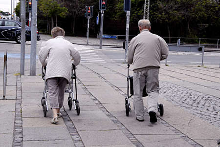 eldlery: KASTRUP COPENHAGEN DENMARK-Danish senior couple walk with walkers          03 July   2014