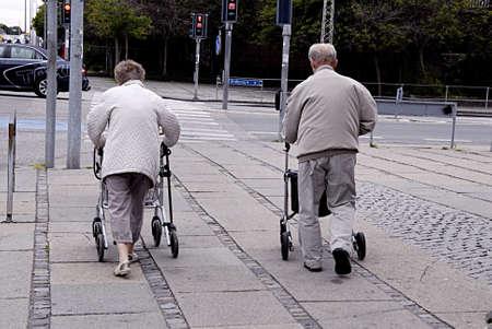 KASTRUP COPENHAGEN DENMARK-Danish senior couple walk with walkers          03 July   2014