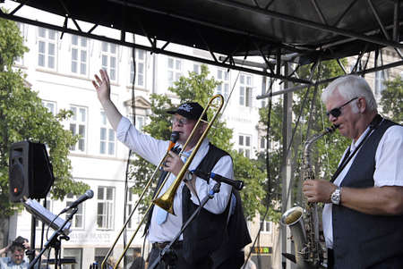 public spirit: COPENHAGEN DENMARK-  Danish bank The Spirit of New Oreleans  Preben Nissen leader and Piano,vocal and trombone Carsten Henningsen Banjo and Vocal Stig Holm Nielsen Base and Jan Schi�ffe Drummer  playing and entertaining public at annual event Copenhagen  Editorial