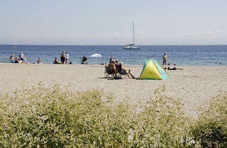 sun bathers: KASTRUP COPENHAGEN DENMARK- Sun bathers and swimmers and beach life at Amage Strand Park today on         06 July   2014