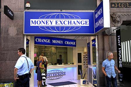 cashing: COPENHAGEN DENMARK-   Travelers at money exchange on stroeget today        11 July  2014