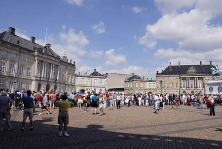 COPENHAGEN DENMARK-Trvelers with their cameras iphone and ipad gether at Aamlienborg Palace royal guards change thought H.M.The Queen Margrethe II is not in palace and there is no fanfair during royal guard change during summer          17 July  2014