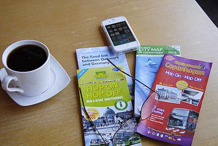 deeds: KASTRUP COPENHAGEN DENMARK- Traveling deeds ip�hone  city maps and informtions with cup of coffee        20 July   2014