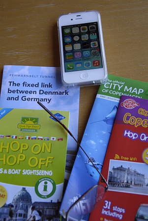 deeds: KASTRUP COPENHAGEN DENMARK- Traveling deeds ip�hone  city maps and informtions with cup of coffee        20 July   2014   Editorial