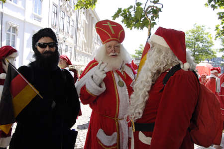 COPENHAGEN DENMARK- Over hundrand years old trandition Interantional Santa Conference ,sants get to gether for 3 days  dinne christmas tradtion dinneer parade on sroeget pedstrain street and bath on beach  participantes are from world wide canada united  Editorial