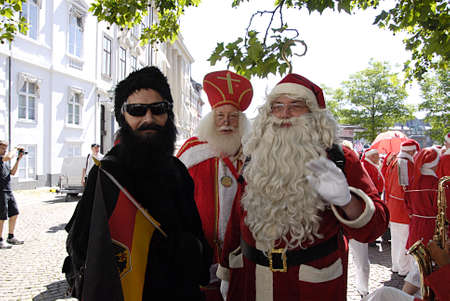 dinne: COPENHAGEN DENMARK- Over hundrand years old trandition Interantional Santa Conference ,sants get to gether for 3 days  dinne christmas tradtion dinneer parade on sroeget pedstrain street and bath on beach  participantes are from world wide canada united  Editorial