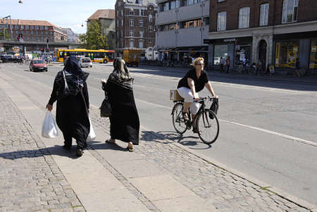 COPENHAGEN DENMARK-Danish female biker and immigrant females norrebrogade          24 July  2014