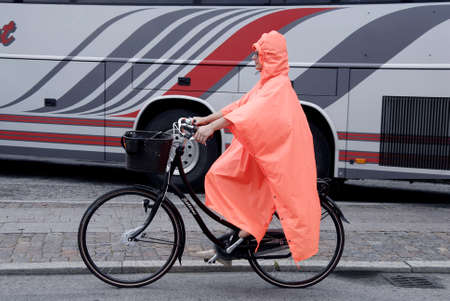 COPENHAGEN DENMARK-Female bicyclist bicycling in rain today on wedesday after very hot summer weeks           30 July  2014