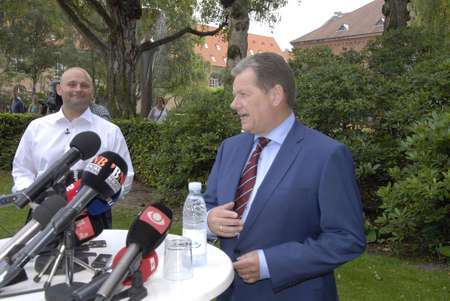 conservative: COPENHAGEN DENMARK- Lars Barfoed in blue suit resigned from leadership and chairmanship from Conservative political party  and interduce new leader and chairman  Soren Pape Poulsen(S�ren Pape Poulsen) bald head and in white shirt holds press conference