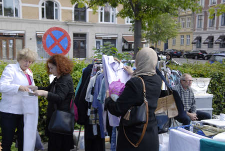 7FREDERISKBERGCOPENHAGEN DENMARK-Consumers at saturdays flearmarket at Frederiksberg city hall gound           16 Auguest  2014