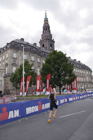 COPENHAGEN DENMARK-  Male and female running in Ironman sport event ironman evet photos are taken at infrom danish parliament house christiansborg and NovoNordic team chaning diabetes and  medicine awareness today at Ironman event on         24 Auguest   Editöryel