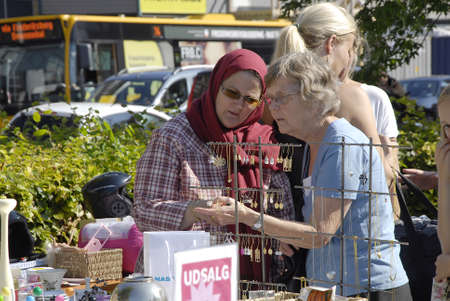 FREDERIKSBERGCOPENHAGEN DENMARK- Consumes at saturdays flea market  items like native american figures and cow boys figures and old cloths on sale  flea market is milions danish kroners business       06 sept.  2014   Editorial