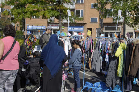 old items: FREDERIKSBERGCOPENHAGEN DENMARK- Consumes at saturdays flea market  items like native american figures and cow boys figures and old cloths on sale  flea market is milions danish kroners business       06 sept.  2014