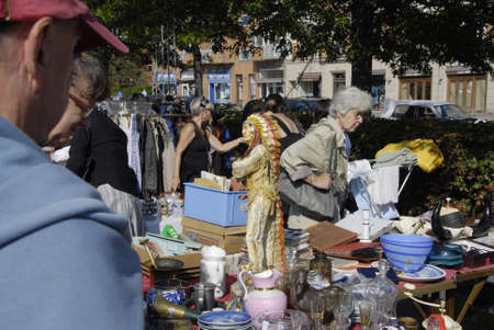 FREDERIKSBERGCOPENHAGEN DENMARK- Consumes at saturdays flea market  items like native american figures and cow boys figures and old cloths on sale  flea market is milions danish kroners business       06 sept.  2014