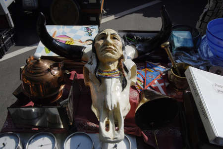 fem: FREDERIKSBERGCOPENHAGEN DENMARK- Consumes at saturdays flea market  items like native american figures and cow boys figures and old cloths on sale  flea market is milions danish kroners business       06 sept.  2014   Editorial
