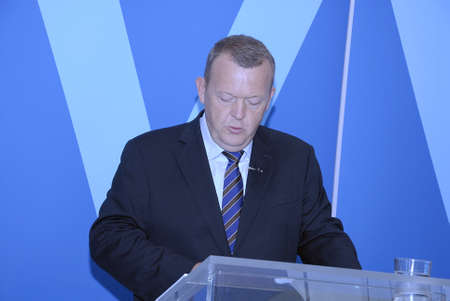 danish prime minister: COPENHAGEN DENMARK- Danish Venster_liberal political party high light with party danish state annual budget 2014 at joing press conference at Christiansborg  Center for prime minister and pary chariman Lars Lokke Rasmussen with copy of their anuall budge