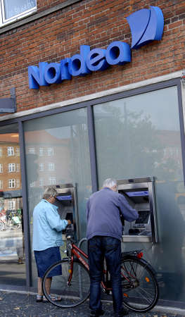 eldlery: COPENHAGEN DENMARK-   Eldlery couple cashing money from Nordea Banks automats        08 sept.  2014