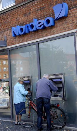 COPENHAGEN DENMARK-   Eldlery couple cashing money from Nordea Banks automats        08 sept.  2014