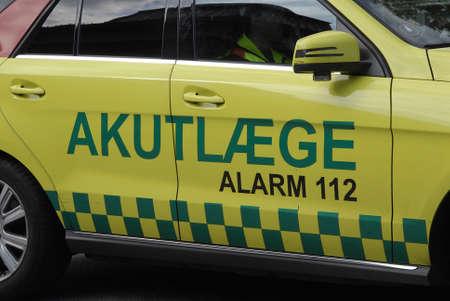 light duty: COPENHAGEN DENMARK-   Danish medical emergency auto amublance among trafic not blue light emergency duty transportation        11 sept.  2014