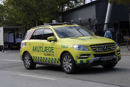 COPENHAGEN /DENMARK- Danish medical emergency auto amublance\ among trafic not blue light emergency duty transportation 1 sept.\ 2014\