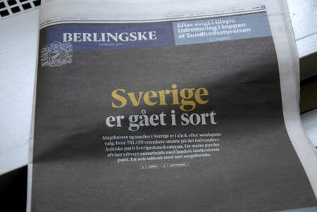 voted: COPENHAGENDENAMK_Danish largest daily Berlingske  black front page and text reads   Sweden gone dak due to swedish elections on 14 sept.2014 uncertin political landscape of sweden  anti immigrantion  paty sedish democrat won 13 pecent sweden voted fo swe Editorial