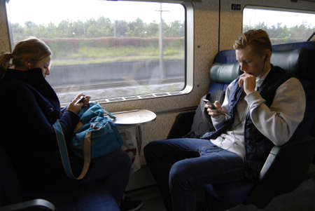 htc: COPENHAGENDENAMK_  Train passenger using free intenet and hi fi on danish public transport train and including buses and  texting  reading  messages and emails and listening music on smartphones iphone and other smartphones today on              26 Septe