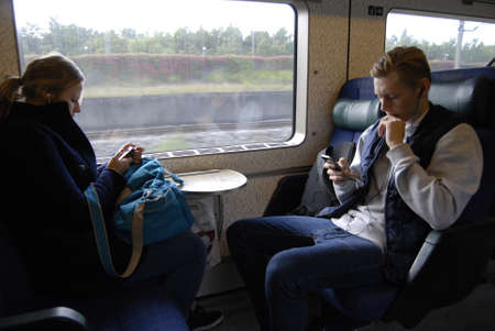 hi fi: COPENHAGENDENAMK_  Train passenger using free intenet and hi fi on danish public transport train and including buses and  texting  reading  messages and emails and listening music on smartphones iphone and other smartphones today on              26 Septe